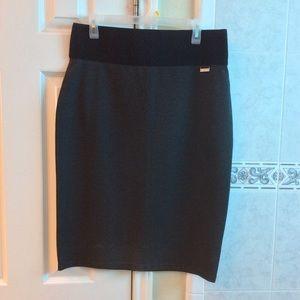 Charcoal gray skirt.